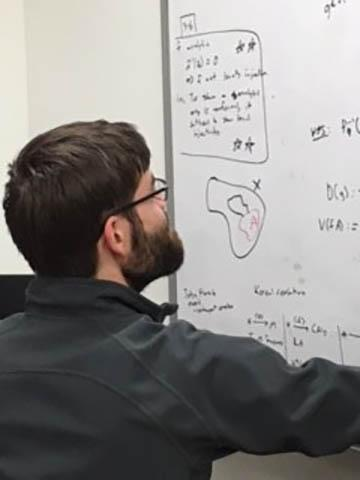 Grad Student working out problem
